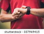 runner using heart rate monitor ... | Shutterstock . vector #337969415