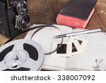 old camera closeup on brown... | Shutterstock . vector #338007092
