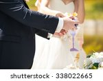 the bride and groom perform a... | Shutterstock . vector #338022665