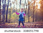 little girl dancing in the park | Shutterstock . vector #338051798