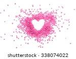 heart shape from pink candies... | Shutterstock . vector #338074022