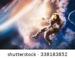 astronaut floating in the... | Shutterstock . vector #338183852