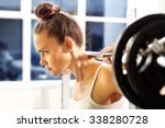 weight lifting. the woman is... | Shutterstock . vector #338280728