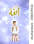 Small photo of Muslim young boy praying on bokeh background..The words spell is Allah means the God of Islam.