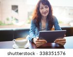 mature student using tablet in... | Shutterstock . vector #338351576