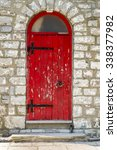 an old curved top red door with ... | Shutterstock . vector #338377982