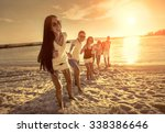 friends fun on the beach under... | Shutterstock . vector #338386646