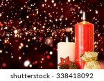 snow against red and gold... | Shutterstock . vector #338418092