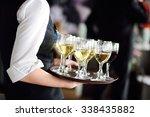 waitress holding a dish of... | Shutterstock . vector #338435882