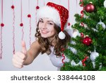 Woman In Santa Hat Thumbs Up...