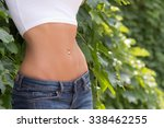 sexy young woman midriff belly... | Shutterstock . vector #338462255