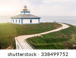 lighthouse on the edge of the... | Shutterstock . vector #338499752
