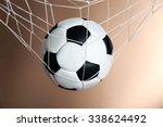 soccer ball in the net on brown ... | Shutterstock . vector #338624492