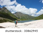 hiker in caucasus mountains | Shutterstock . vector #33862945