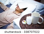 asian man reading book on bed... | Shutterstock . vector #338707022