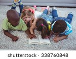 happy kids reading a book... | Shutterstock . vector #338760848