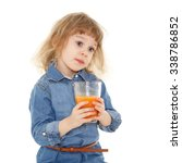 little sweet girl drinks carrot ... | Shutterstock . vector #338786852