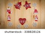wooden christmas figurines... | Shutterstock . vector #338828126