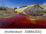 Red Artificial Lake And Hills...