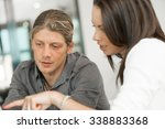 young coworkers working... | Shutterstock . vector #338883368