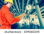 happy asian engineers writing... | Shutterstock . vector #339060245