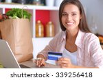 smiling woman online shopping... | Shutterstock . vector #339256418