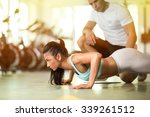 personal trainer working with... | Shutterstock . vector #339261512