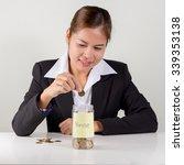 Business Woman Saving Money...