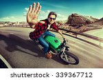 man riding motorcycle in ... | Shutterstock . vector #339367712