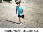 young man jogging at stairs... | Shutterstock . vector #339381566