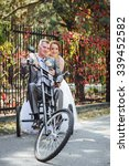 funny couple on a bicycle | Shutterstock . vector #339452582