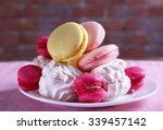 Plate With Sweet Cakes On Pink...