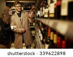 couple choosing alcohol in a...   Shutterstock . vector #339622898