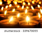 many candle flames glowing in... | Shutterstock . vector #339670055