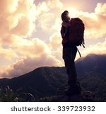 young woman backpacker hiking... | Shutterstock . vector #339723932