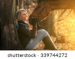 young beautiful girl with horse ... | Shutterstock . vector #339744272