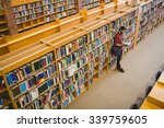 student reading a book from... | Shutterstock . vector #339759605