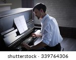 Handsome Man Plays Piano In Th...