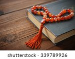holy quran with beads over... | Shutterstock . vector #339789926