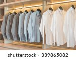 white and grey shirts hanging... | Shutterstock . vector #339865082