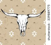Bull skull with horns on native americans background with traditional ornament