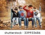 four boys in superhero costume... | Shutterstock . vector #339933686