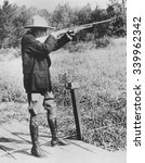 Small photo of Pres. Calvin Coolidge shooting clay pigeons at Bruel, Wisconsin. Sept. 5, 1928. Calvin Coolidge spent his 1928 summer vacation at Cedar Island, a private estate of the late Henry Clay Pierce.