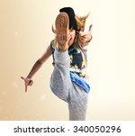 Street Dance Woman Giving A Kick