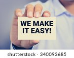 Stock photo we make it easy message on the card shown by a man vintage tone 340093685