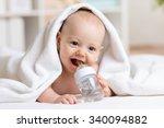 happy baby boy drinks water... | Shutterstock . vector #340094882
