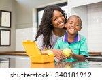 smiling mother preparing sons... | Shutterstock . vector #340181912