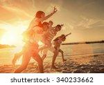 friends fun on the beach under... | Shutterstock . vector #340233662