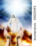 Jesus Christ with human hands in gesture of tender love, hope and praying over sky with rays of divine light - stock photo