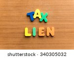 Small photo of tax lien colorful word on the wooden background